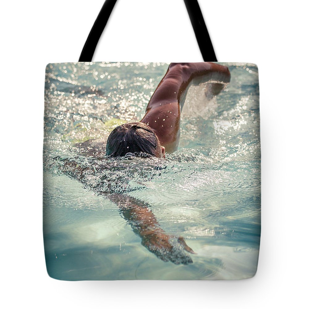 One Man Tote Bag featuring the photograph Young Man Swimming by Pier Giorgio Mariani