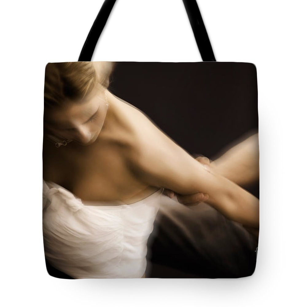 Fight Tote Bag featuring the photograph Young Woman Escaping From A Man by Oleksiy Maksymenko