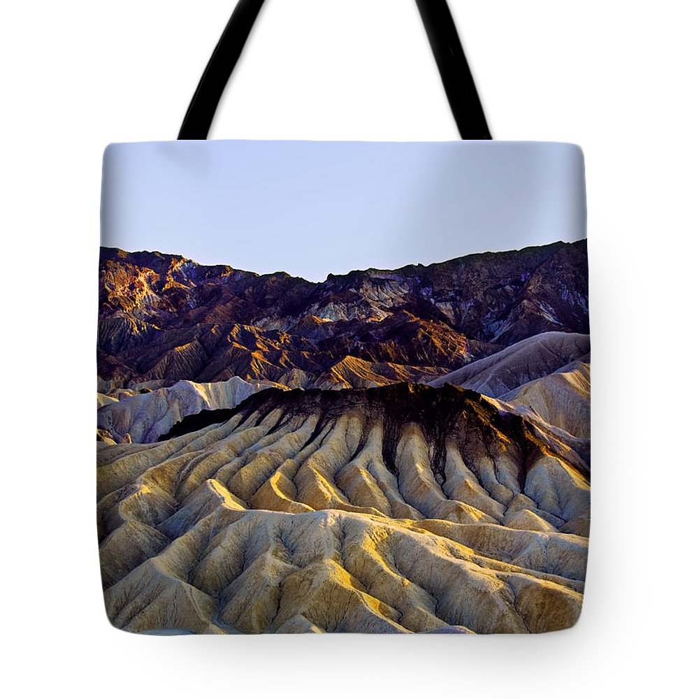 Death Valley Tote Bag featuring the photograph zabriskie point waves PM glow two by Paul Basile