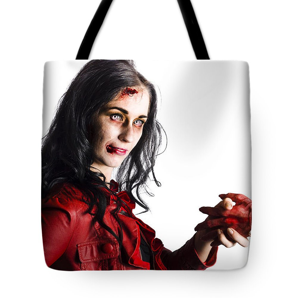 Accident Tote Bag featuring the photograph Zombie Shaking Severed Hand by Jorgo Photography - Wall Art Gallery