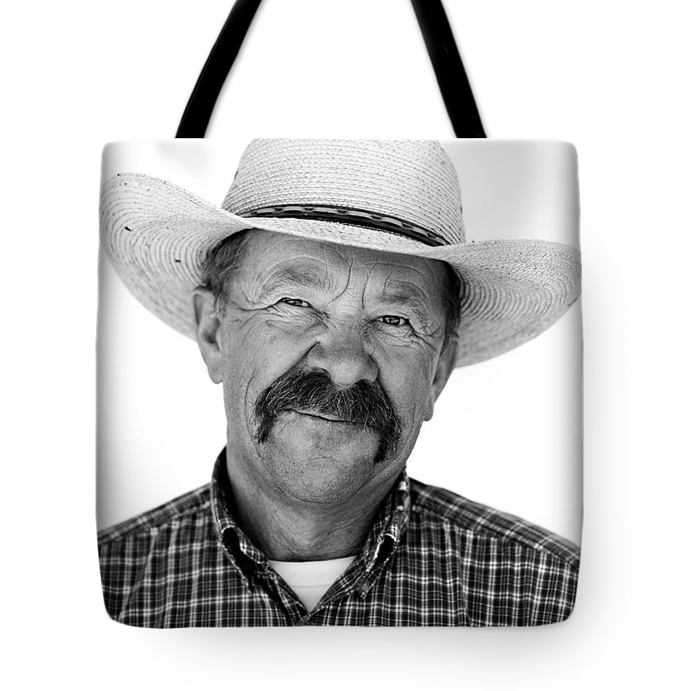 Mature Adult Tote Bag featuring the photograph A Black And White Portrait Of A Cowboy by Rachid Dahnoun