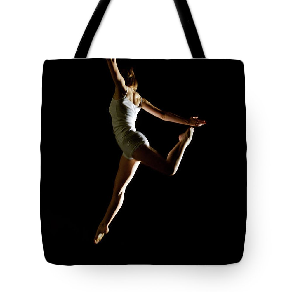 Ballet Dancer Tote Bag featuring the photograph Ballet And Contemporary Dancers by John Rensten