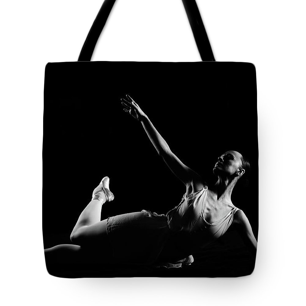 Expertise Tote Bag featuring the photograph Classical Dancer by Oleg66