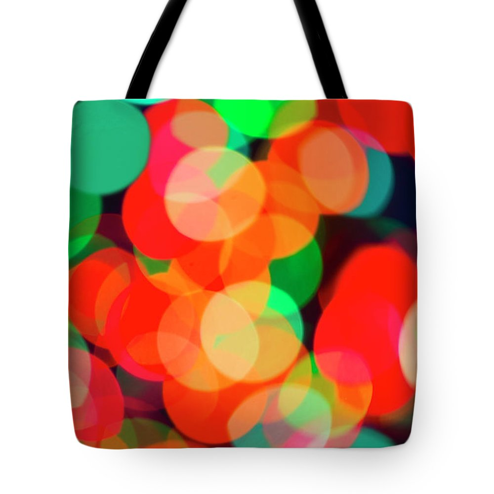Holiday Tote Bag featuring the photograph Defocused Lights by Tetra Images