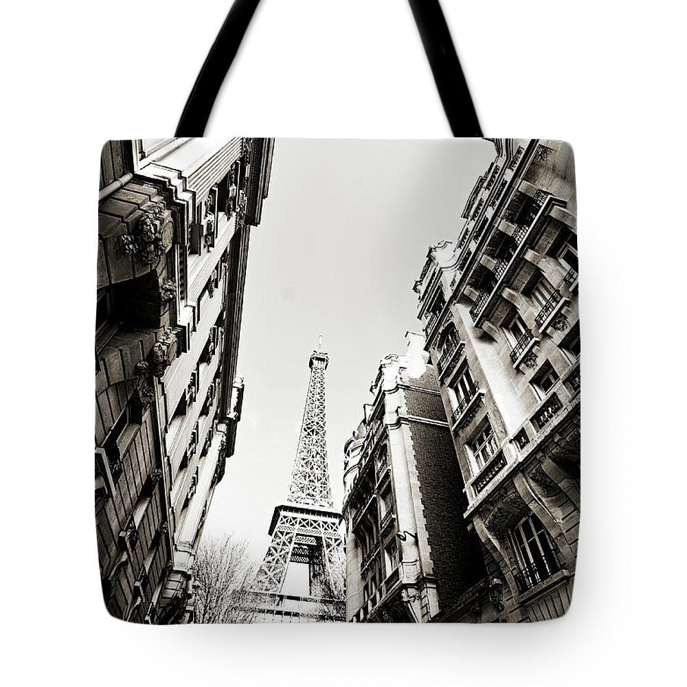 Built Structure Tote Bag featuring the photograph Eiffel Tower Between Buildings In by Flory