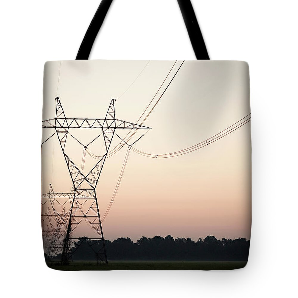 Tranquility Tote Bag featuring the photograph Electrical Power Lines Against The by Wesley Hitt