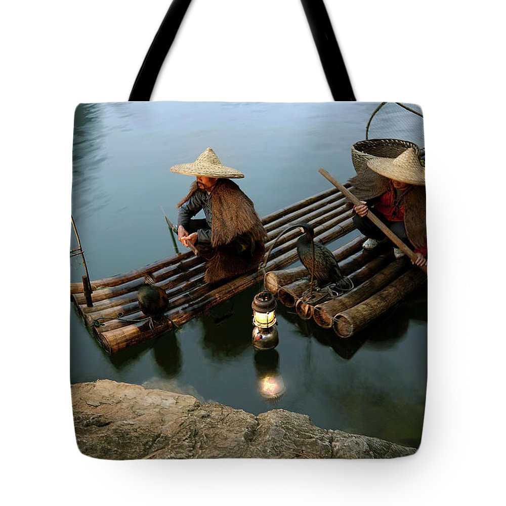 Yangshuo Tote Bag featuring the photograph Fishing With Cormorants by Kingwu