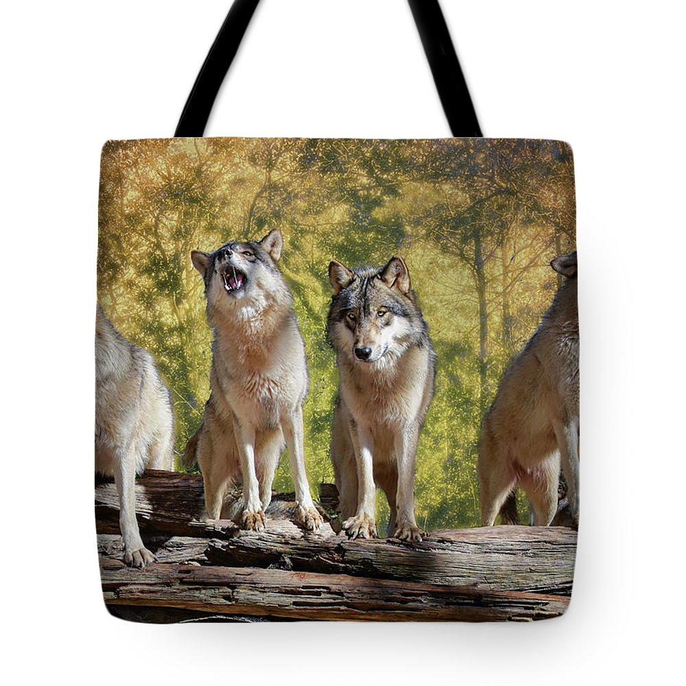 Wolf Tote Bag featuring the photograph Howling Wolves by Jeannee Gannuch