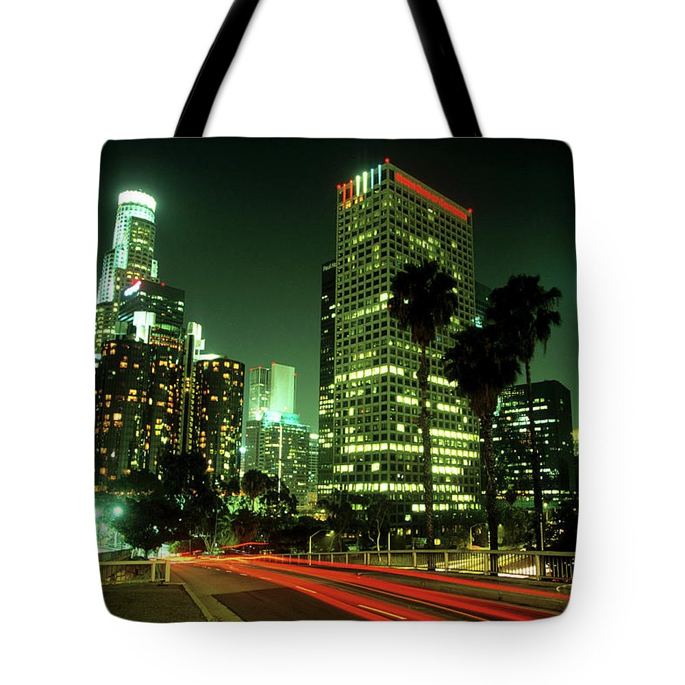 Downtown District Tote Bag featuring the photograph Los Angeles Skyline At Night by Hisham Ibrahim