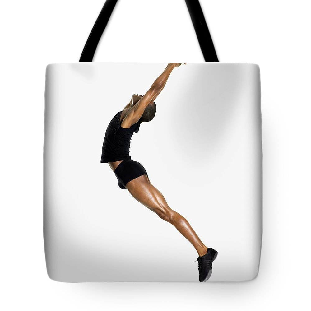 Young Men Tote Bag featuring the photograph Male Dancer Jumping by Image Source