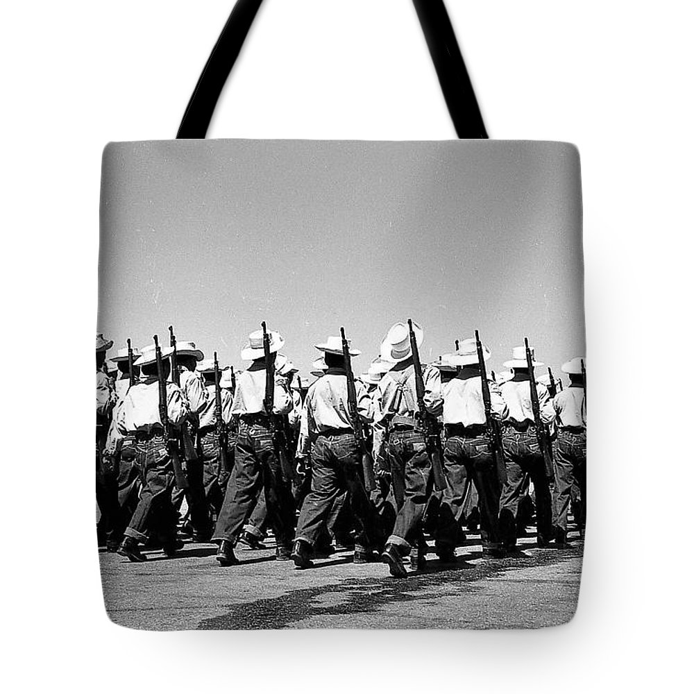 Men Tote Bag featuring the photograph March At Airport by Venancio Diaz