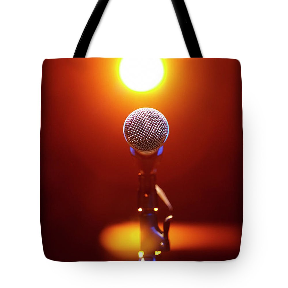 Microphone Stand Tote Bag featuring the photograph Microphone At A Concert by Henrik Sorensen