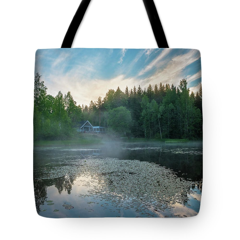 Early Morning Fog Mist Sunrise Sky Haze Lake Pond Water Summer Midsummer Dawn Forest Tree Trees Reflection Reflections Jun Landscape Countryside Summerhouse House Building Finland Tote Bag featuring the photograph Midsummer's Morning by Anita Raunio