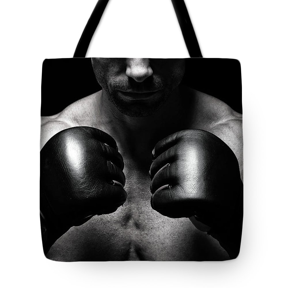 Toughness Tote Bag featuring the photograph Mma Fighter by Vuk8691