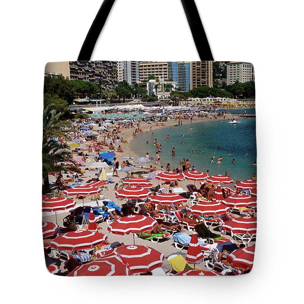 Shadow Tote Bag featuring the photograph Overhead Of Red Sun Umbrellas At by Dallas Stribley