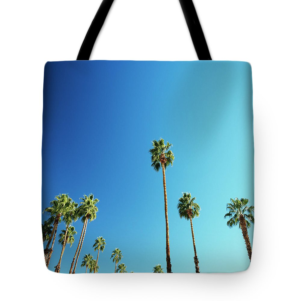 Clear Sky Tote Bag featuring the photograph Palm Trees Against Blue Sky by Micha Pawlitzki
