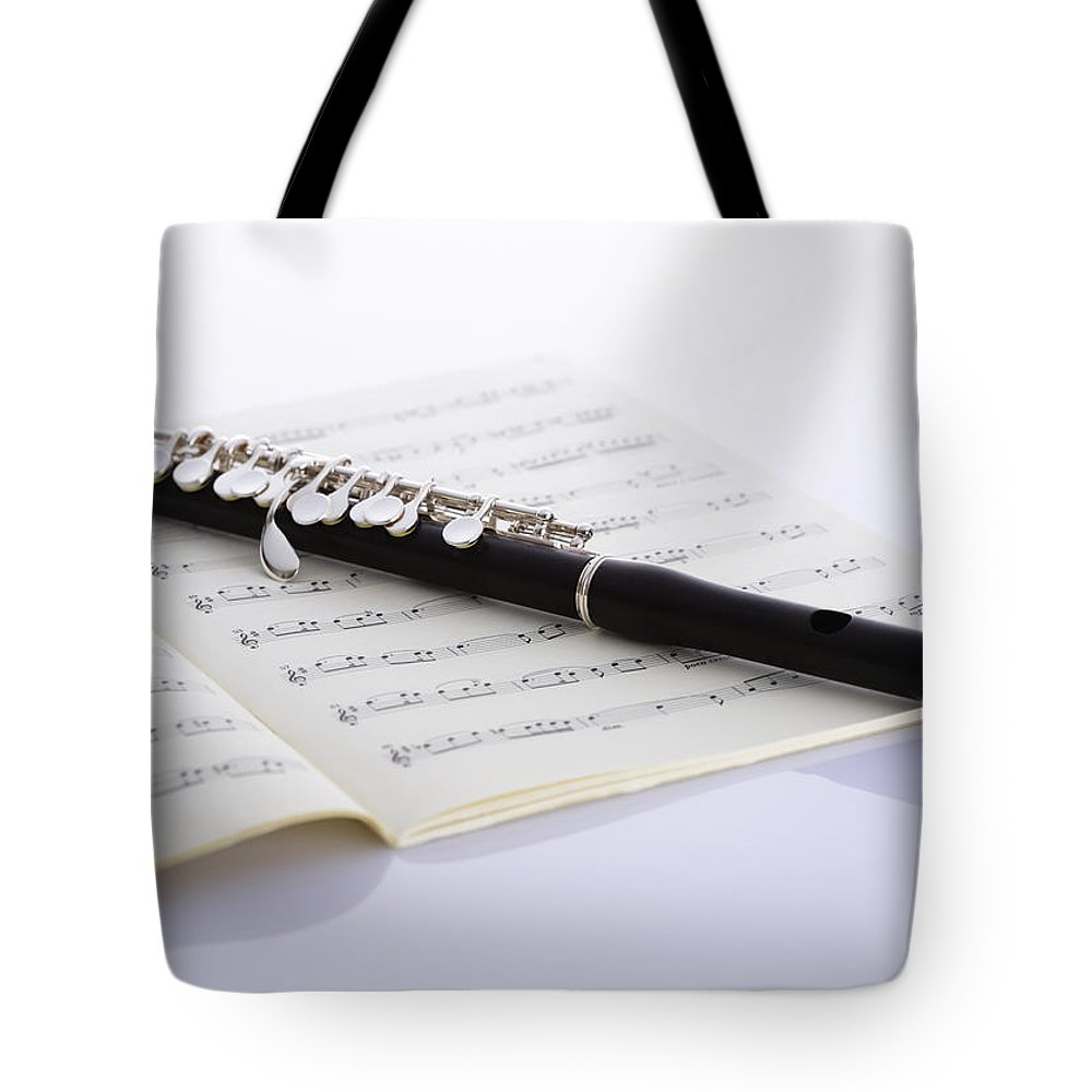 Sheet Music Tote Bag featuring the photograph Piccolo On A Score by Imagenavi