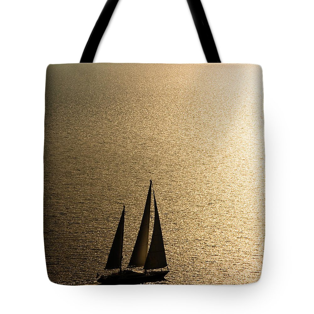 Curve Tote Bag featuring the photograph Sailing At Sunset by Mbbirdy