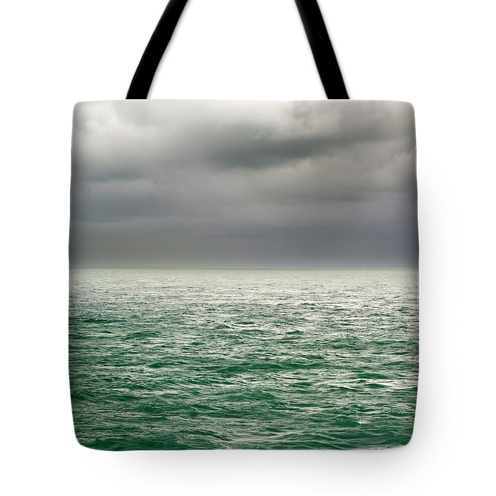 Viewpoint Tote Bag featuring the photograph Sea View by Stockcam