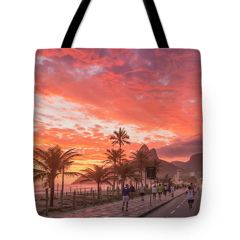 Majestic Tote Bag featuring the photograph Sunset Over Ipanema Beach by Buena Vista Images