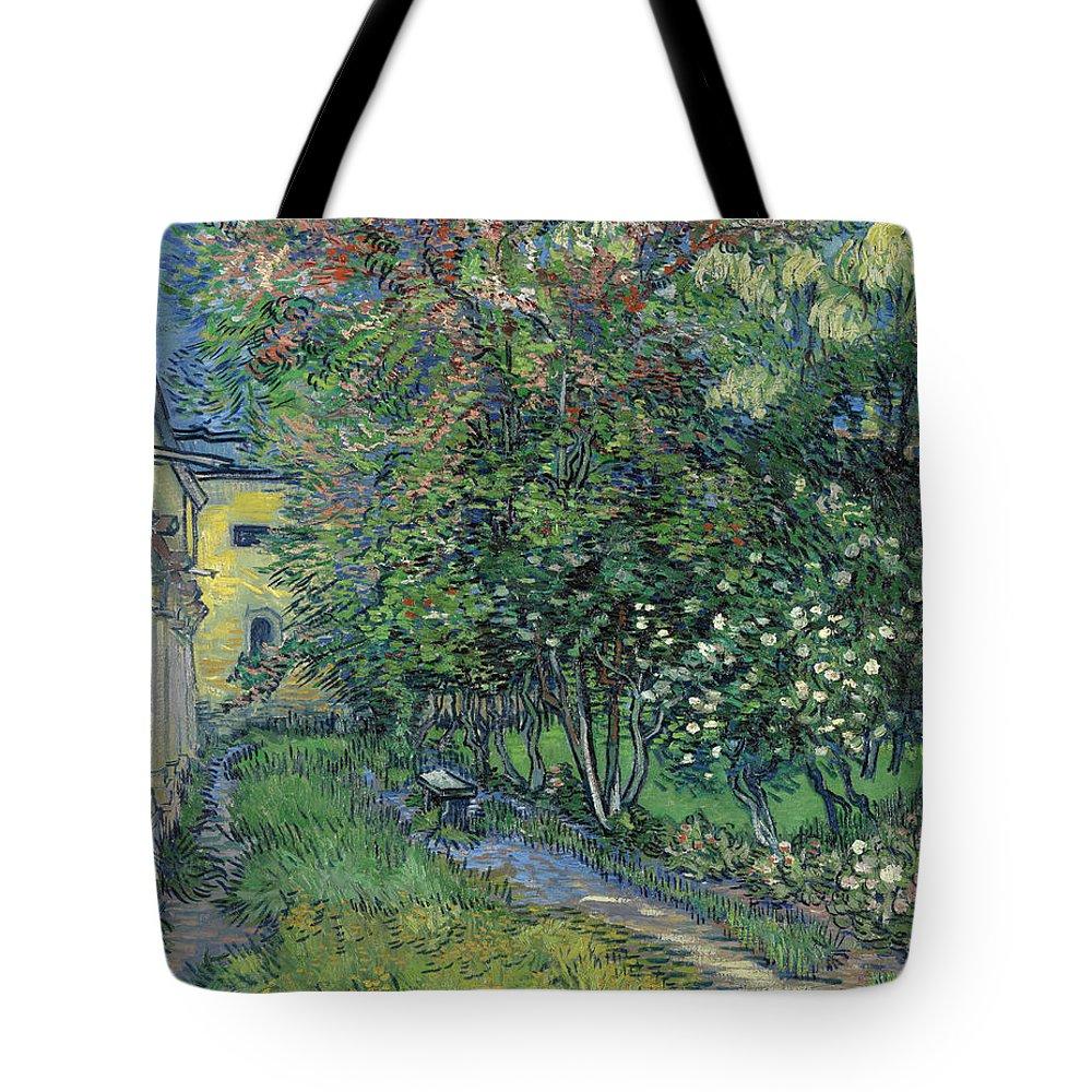 Garden Of The Asylum Tote Bag featuring the painting The Garden Of The Asylum At Saint-remy by Vincent Van Gogh