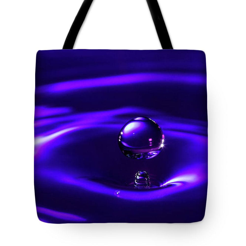 Water Tote Bag featuring the pyrography Water Drop Falling Into Water by Krasimir Kanchev