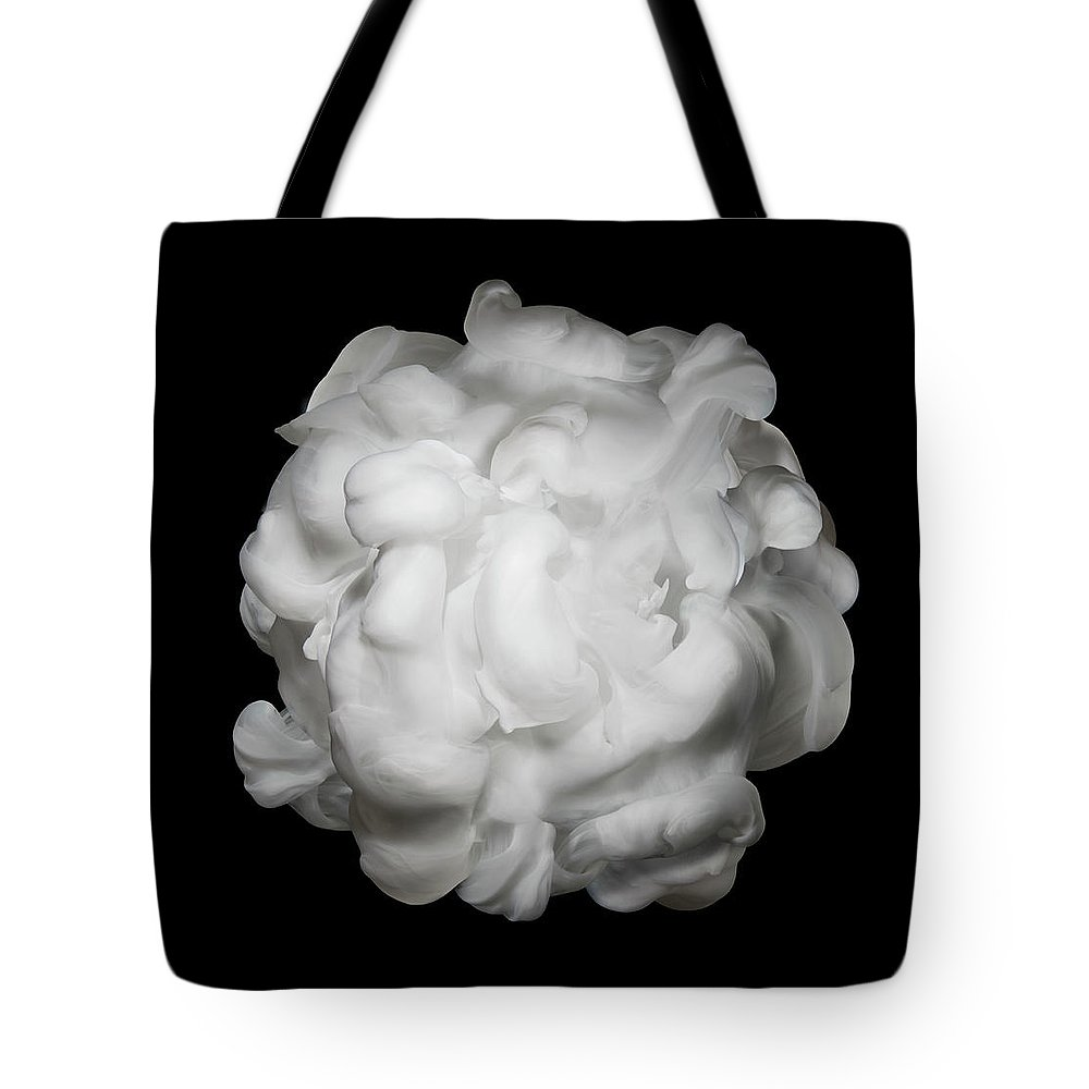 Dissolving Tote Bag featuring the photograph White Ink In Water On Black Background by Biwa Studio