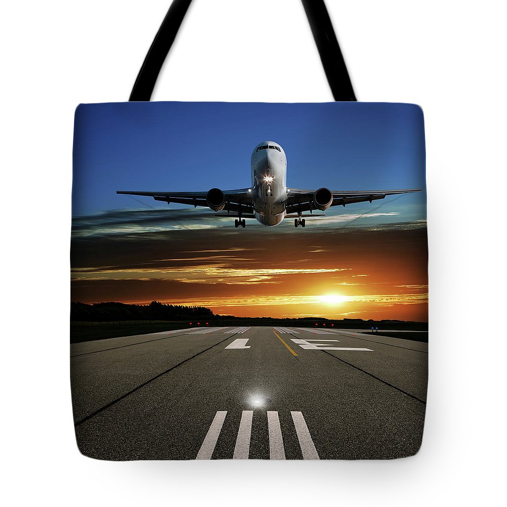 Orange Color Tote Bag featuring the photograph Xl Jet Airplane Landing At Sunset by Sharply done