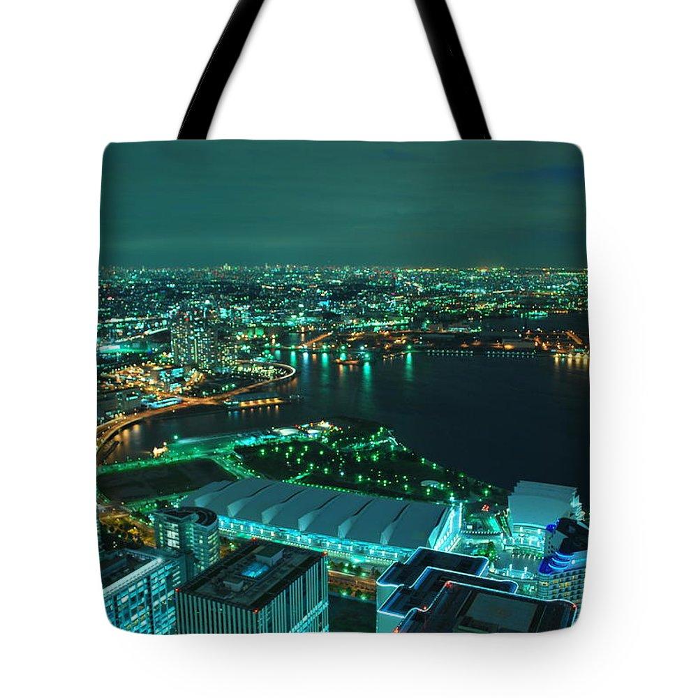 Yokohama Tote Bag featuring the photograph Yokohama by Copyright Artem Vorobiev