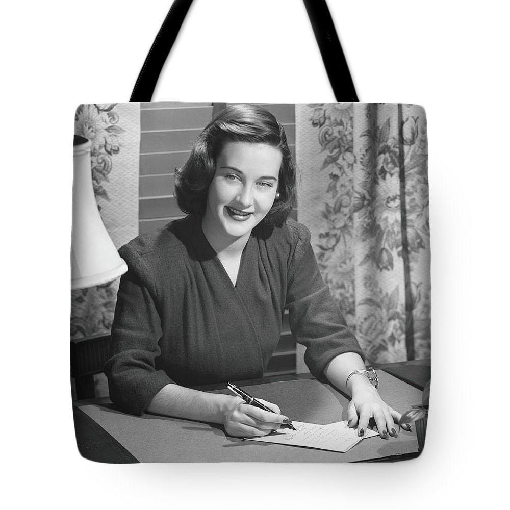 People Tote Bag featuring the photograph Young Woman Writing Letter At Desk, B&w by George Marks