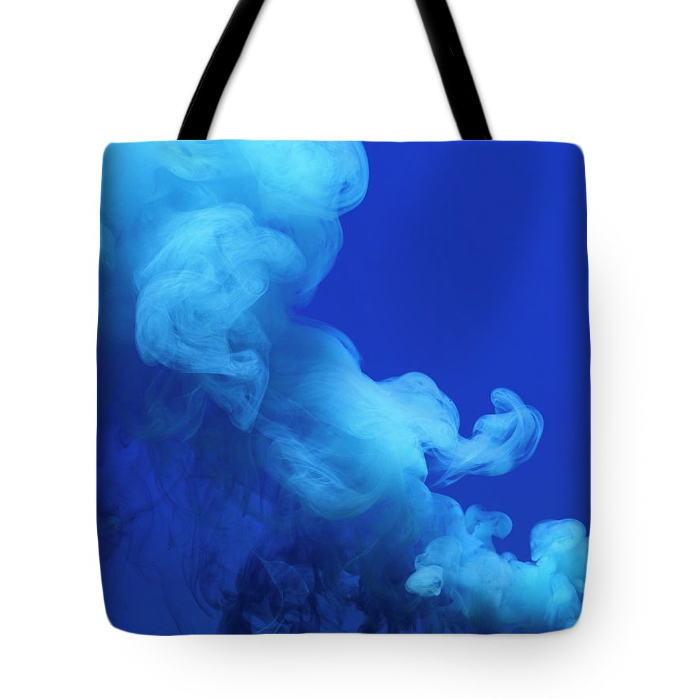 Motion Tote Bag featuring the photograph Colored Smoke by Henrik Sorensen
