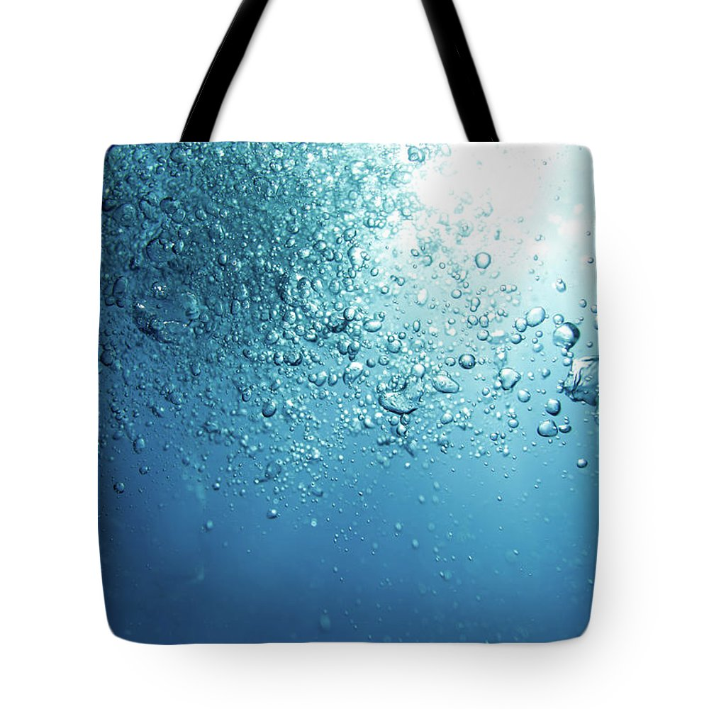 Underwater Tote Bag featuring the photograph Bubbles by Mutlu Kurtbas