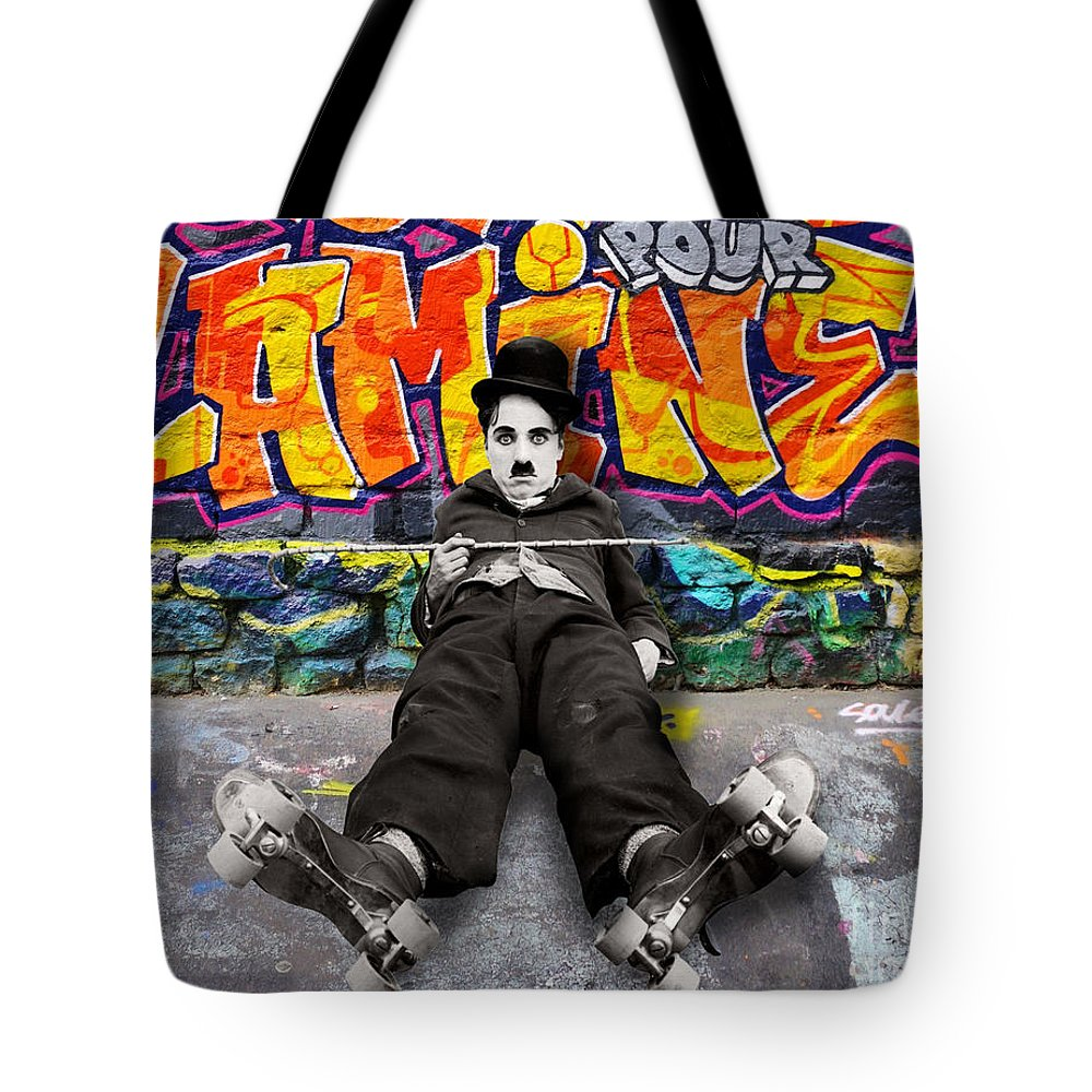 Charlie Chaplin Tote Bag featuring the pyrography Charlie Chaplin by Mark Ashkenazi