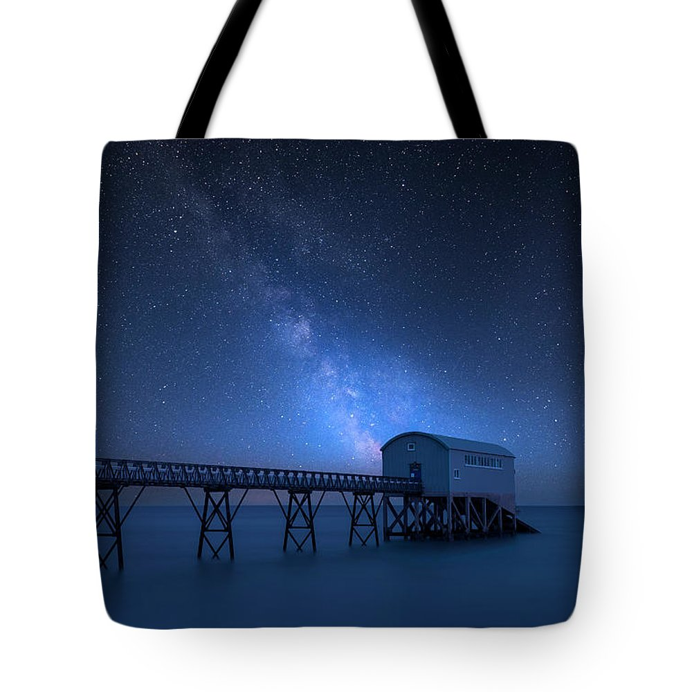 Landscape Tote Bag featuring the photograph Vibrant Milky Way Composite Image Over Landscape Of Long Exposur by Matthew Gibson