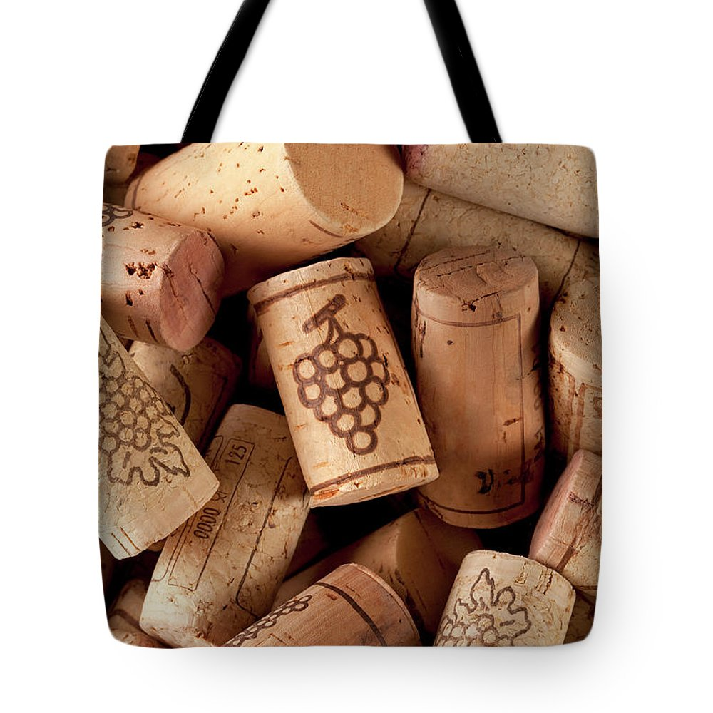 Alcohol Tote Bag featuring the photograph Wine Corks by Malerapaso