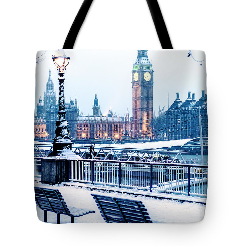 Clock Tower Tote Bag featuring the photograph Houses Of Parliament In The Snow by Doug Armand