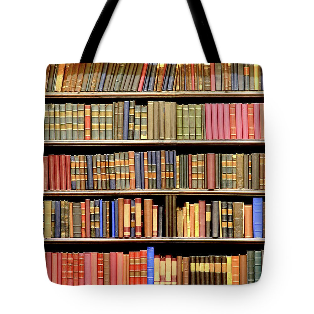 Dust Tote Bag featuring the photograph Old Books In A Library by Luoman