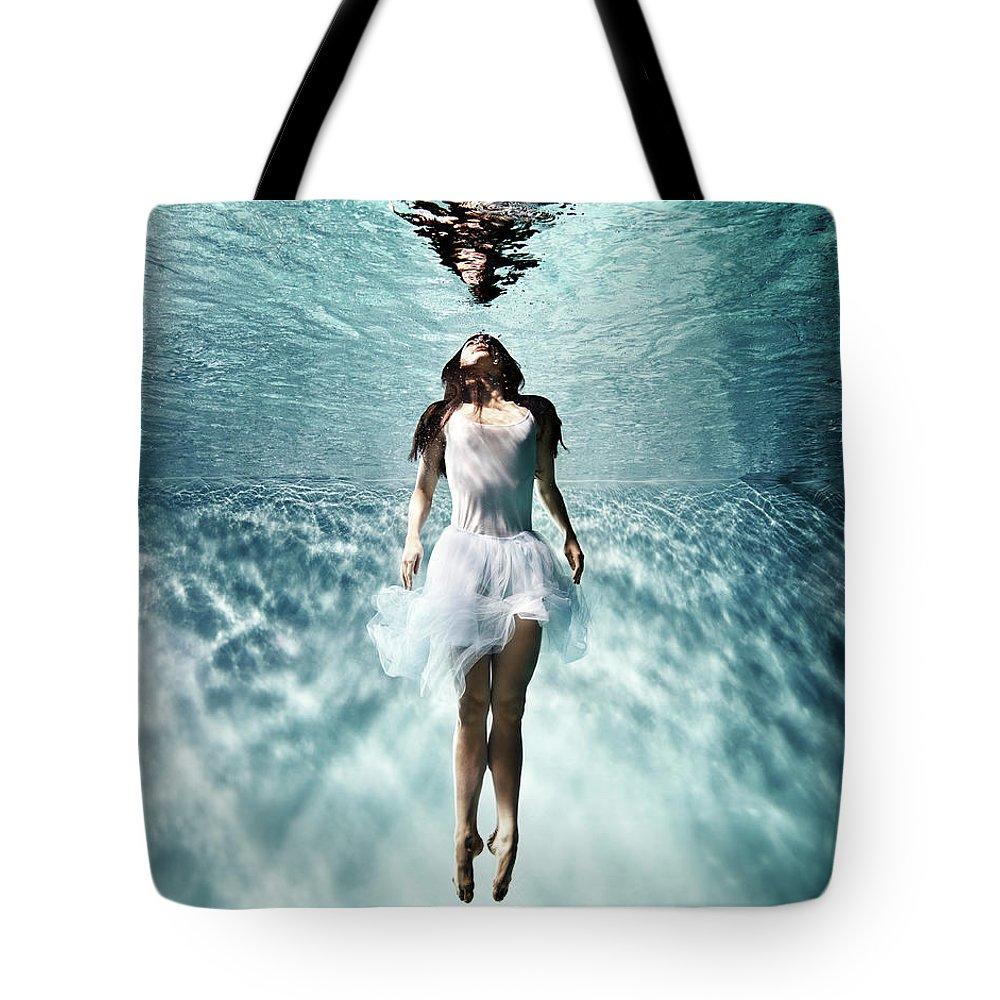 Ballet Dancer Tote Bag featuring the photograph Underwater Ballet by Henrik Sorensen