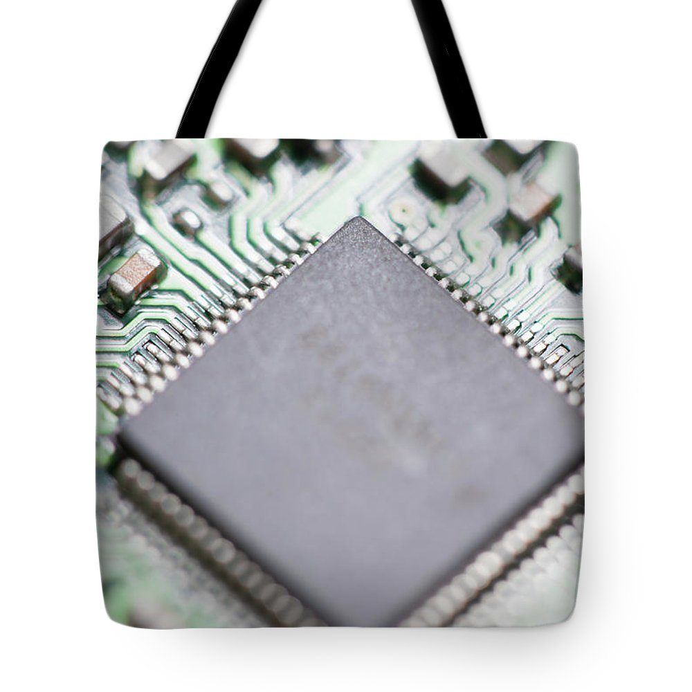 Electrical Component Tote Bag featuring the photograph Close-up Of A Circuit Board by Nicholas Rigg