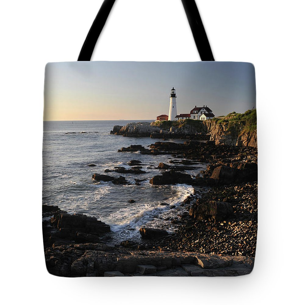 Water's Edge Tote Bag featuring the photograph Portland Head Light by Aimintang