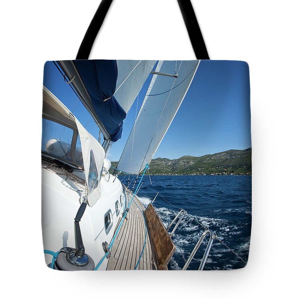 Curve Tote Bag featuring the photograph Sailing In The Wind With Sailboat by Mbbirdy