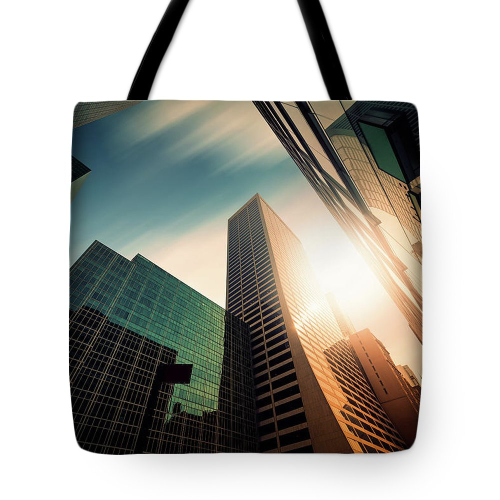 Working Tote Bag featuring the photograph Office Skysraper In The Sun by Ppampicture