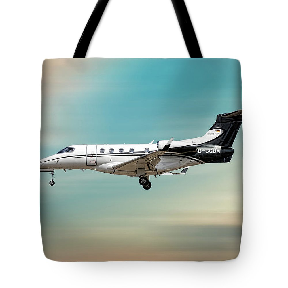 Phenom Tote Bag featuring the mixed media Phenom 300 Arrow by Smart Aviation