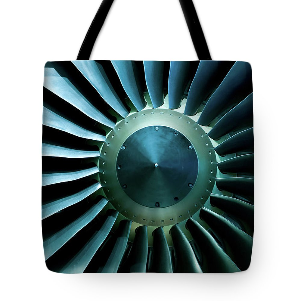 Material Tote Bag featuring the photograph A Close Of Up A Turbine Showing The by Brasil2