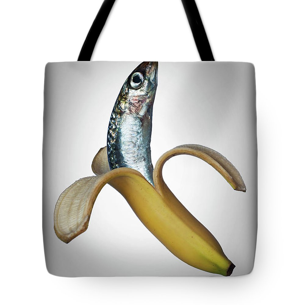Confusion Tote Bag featuring the photograph A Fish In A Banana by Buena Vista Images
