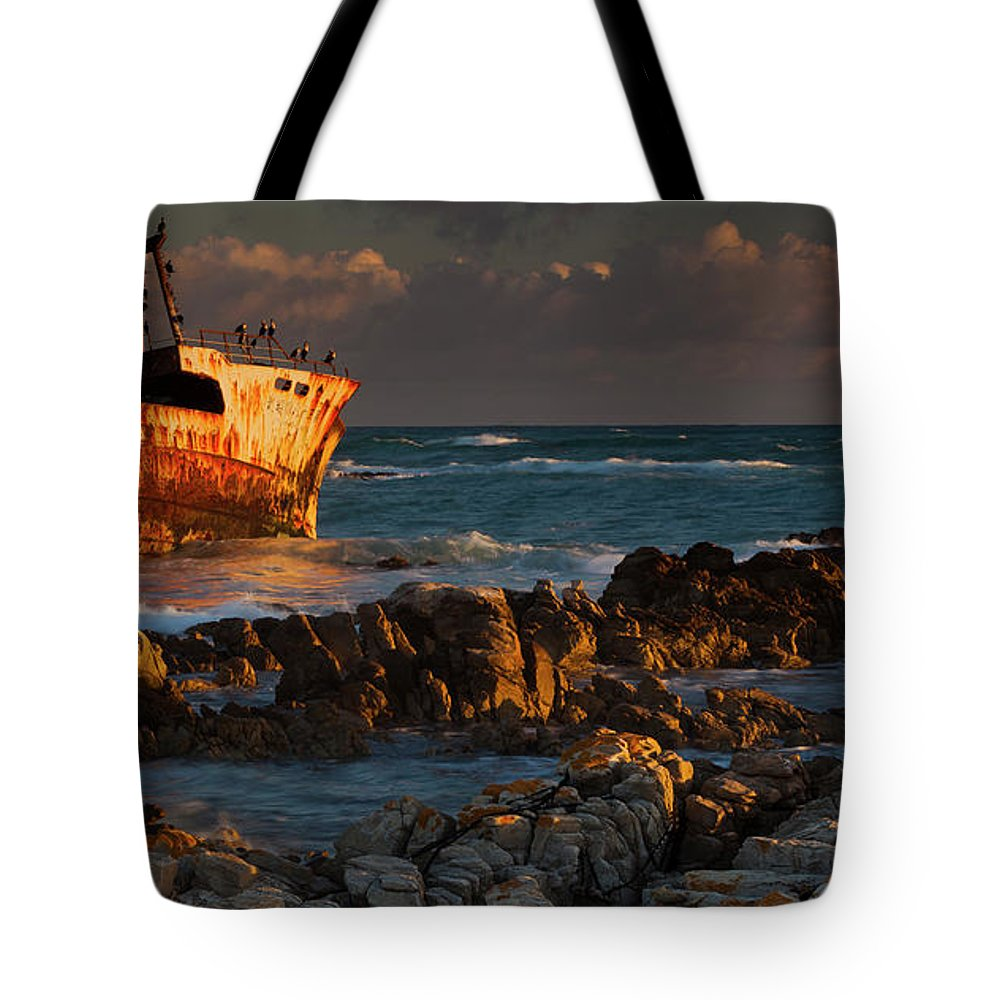 Non-urban Scene Tote Bag featuring the photograph A Rusting Wreck, An Abandoned Ship Off by Mint Images - Art Wolfe