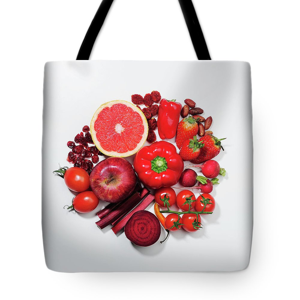 White Background Tote Bag featuring the photograph A Selection Of Red Fruits & Vegetables by David Malan