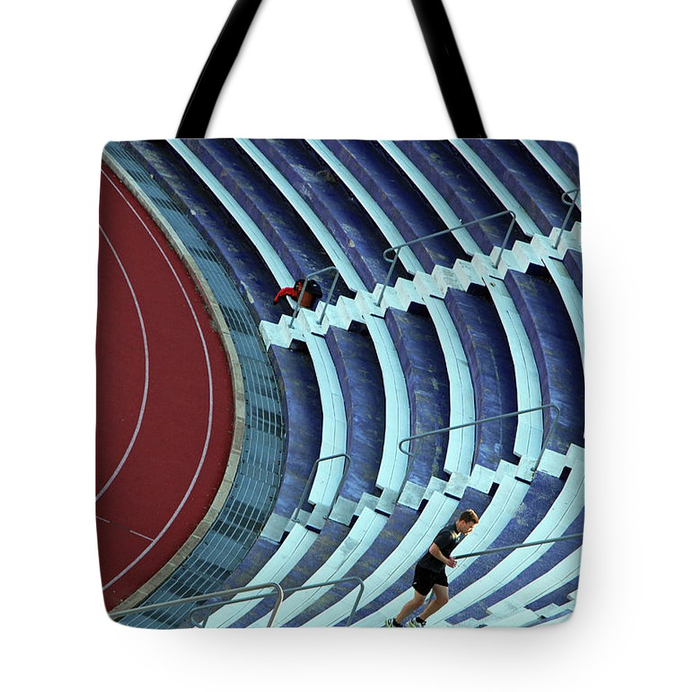 Runner Tote Bag featuring the photograph A Stadium Workout by Cora Wandel