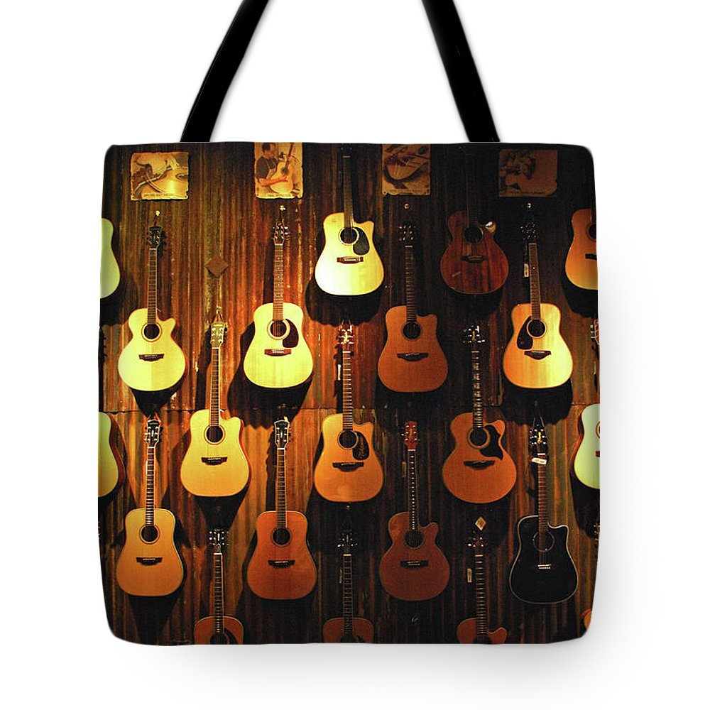 Hanging Tote Bag featuring the photograph Acoustic Guitars On A Wall by Karas Cahill Photography
