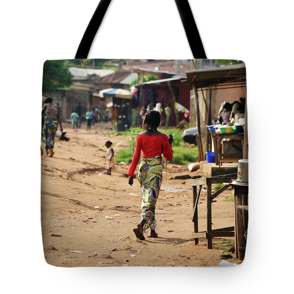 Trading Tote Bag featuring the photograph African Street Scene by Peeterv